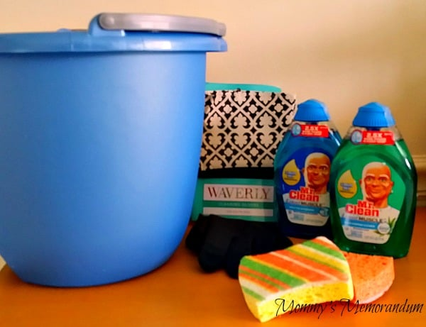 cleaning bucket with sponges and Mr. Clean products