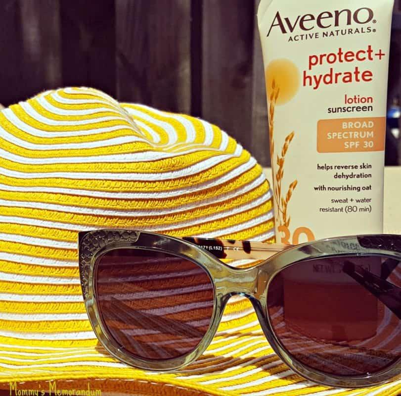 dca2cf7b0c85 ottica coach prescription sunglasses with yellow hat and aveeno sunscreen