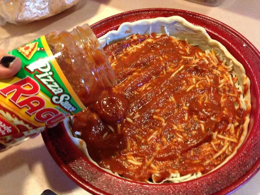 adding more sauce