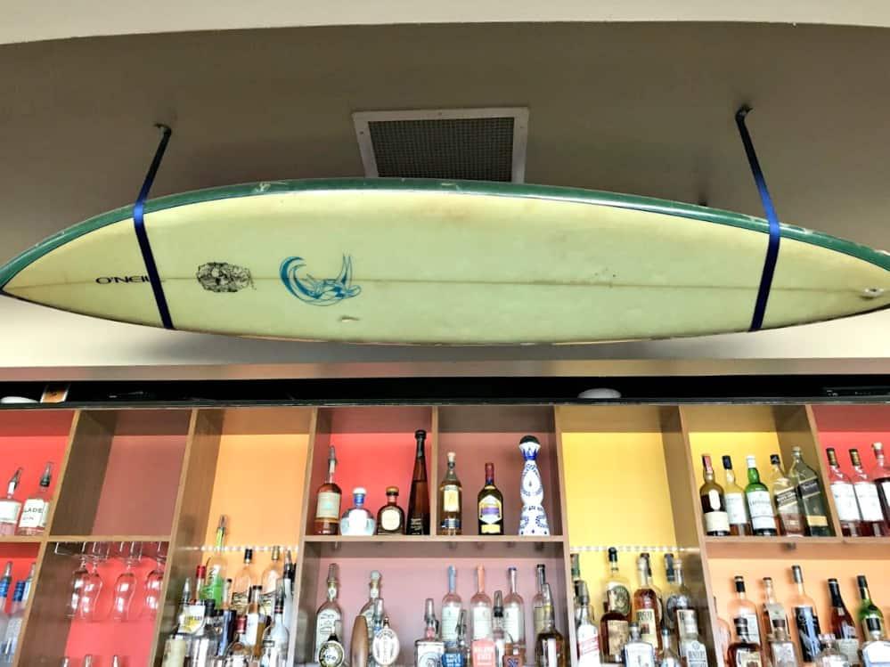 santa cruz jack oneill lounge surfboard over bar